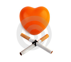 Orange Heart  And Two Cigarettes. Stock Photography - Image: 19778522