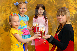 Young Woman Give Gifts To The Children Stock Photos - Image: 19781543