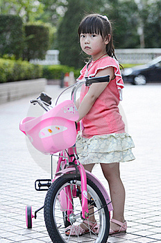 Asian Child Riding A Bicycle Royalty Free Stock Photos - Image: 19782308