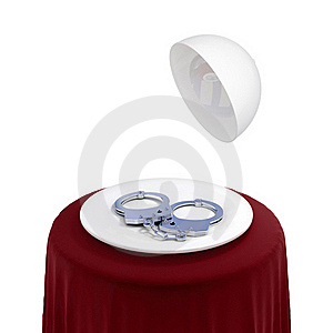 Round Table With Red Cloth And Handcuff On A Dish. Royalty Free Stock Photography - Image: 19784147
