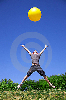 Young Man Jump With Yellow Ball Stock Image - Image: 19795791