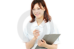 Young Asian Female Nurse In Uniform, Holding A Cli Royalty Free Stock Photo - Image: 19802715