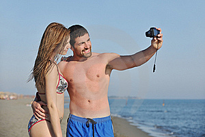 Happy Young Couple Have Fun On Beach Royalty Free Stock Images - Image: 19808859