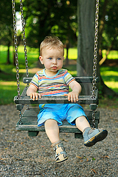 Little Boy Swinging Royalty Free Stock Photos - Image: 19814898