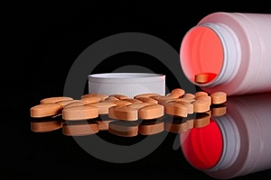 Pill Bottle With Orange Pills Royalty Free Stock Photography - Image: 19826817