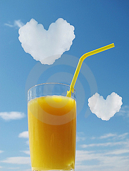 Orange Juice In Glass. Hearts In A Sky Stock Images - Image: 19829564
