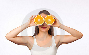 Young Woman With Halved Orange Royalty Free Stock Images - Image: 19840999