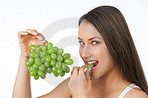 Young Woman Eating Grapes Stock Photography - Image: 19841062