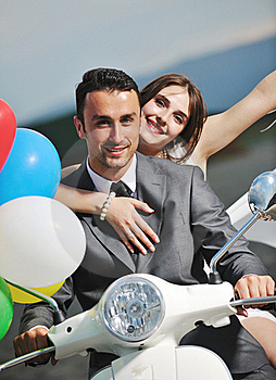 Just Married Couple Ride White Scooter Royalty Free Stock Photos - Image: 19857598