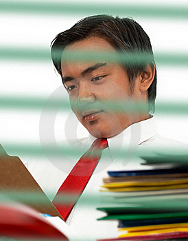 Man Reading A Document Royalty Free Stock Photo - Image: 19870405