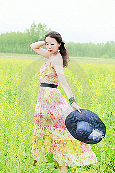 Asian Girl In Rape Field Royalty Free Stock Image - Image: 19873056