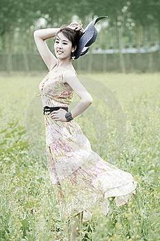 Asian Model Posing In Rape Field Royalty Free Stock Photo - Image: 19875065