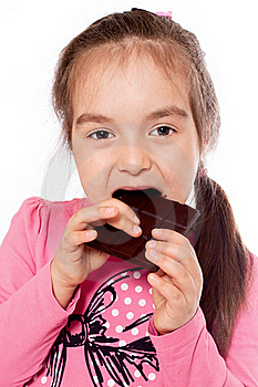 Girl Eating Chocolate Royalty Free Stock Image - Image: 19881396