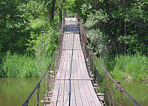 Old Suspension Walk Bridge Across River In Forest Stock Photo - Image: 19883460