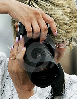 Woman the photographer Royalty Free Stock Photography