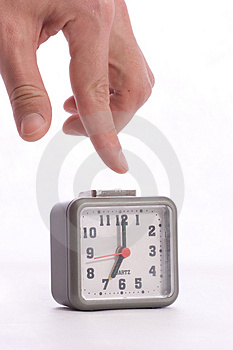 Turning off alarm on the alarm clock Royalty Free Stock Images