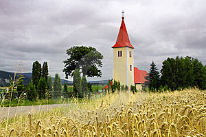 Church In The Forefront Of Grain Royalty Free Stock Photography - Image: 19912697