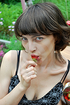 Woman Eating Strawberries Stock Photo - Image: 19918510