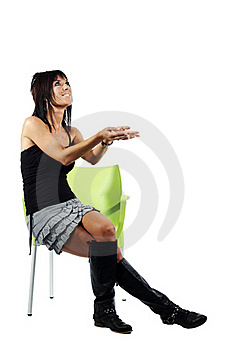 Attractive Woman Gesturing To Her Left Sitting Dow Royalty Free Stock Photography - Image: 19919527
