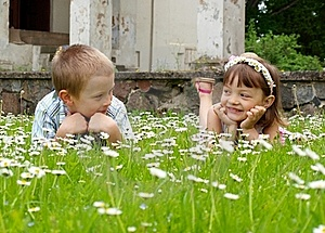 Girl And Boy Lying On The Grass Royalty Free Stock Photos - Image: 19924088
