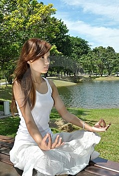 Young Girl Meditating In The Park Royalty Free Stock Image - Image: 19926816