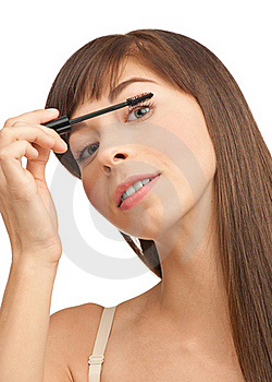 Beautiful Woman Applying Mascara Royalty Free Stock Photography - Image: 19927397