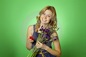 Attractive Girl Holding Flowers And A Gift Box Royalty Free Stock Photos - Image: 19959358