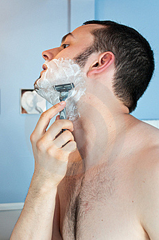 Young Man Shaving His Beard Stock Image - Image: 19967961