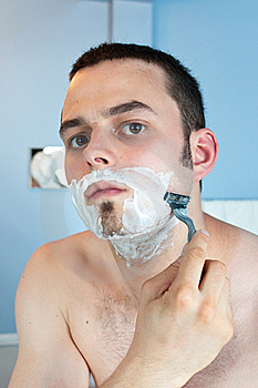 Young Man Shaving His Beard Stock Images - Image: 19967964