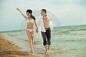 A Married Couple Running In Sunshine Stock Images - Image: 19976964