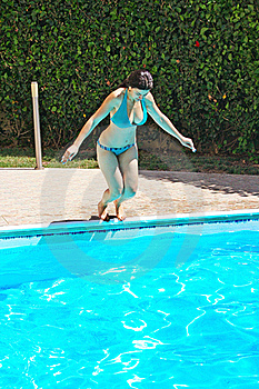 Woman Jumping To Swimming Pool Royalty Free Stock Photos - Image: 19981178