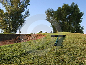 Sand trap and rake Stock Images
