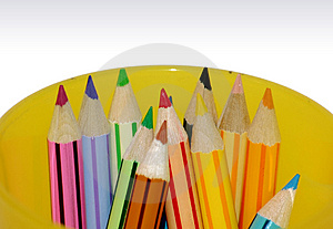 Color pencils in yellow container Stock Image