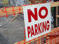 No Parking sign in a neighborhood with graffiti Royalty Free Stock Photo