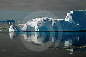 Iceberg in sunlight with water reflection Stock Photo