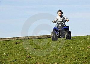 Boy Driving ATV Royalty Free Stock Image - Image: 20007536