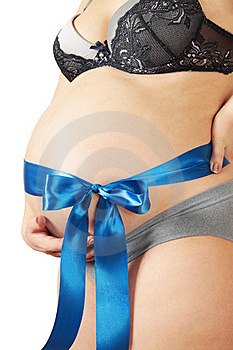 Blue Bow On The Stomach Royalty Free Stock Photo - Image: 20008585