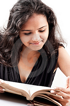 Indian Girl Enjoing Reading Book Stock Images - Image: 20030694