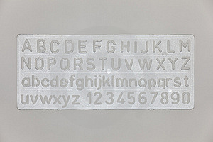 Stencil For Letters And Numbers. Royalty Free Stock Photos - Image: 20031128