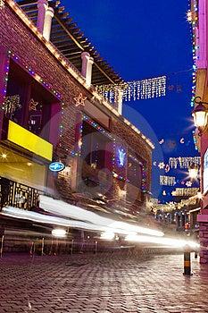 Bar Street At Night With Car Blur Stock Image - Image: 20039181