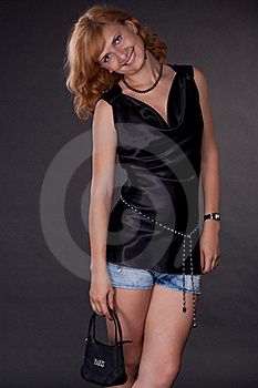 The Girl, Dressed In Black With A Bag Stock Photo - Image: 20054540