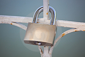Lock Hanging On The Fence Royalty Free Stock Images - Image: 20057249