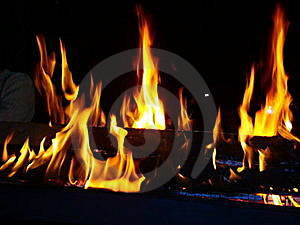 Night Fire on a black background. Royalty Free Stock Photos