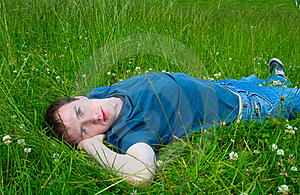 The Young Man Lies On Green Meadow Stock Image - Image: 20070031
