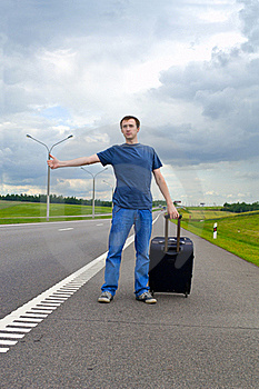 The Young Man Pending On Road With Suitcase Stock Photography - Image: 20070462