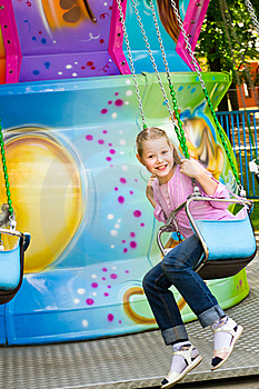 The Beautiful Girl On An Attraction Stock Photo - Image: 20070610