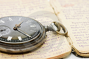 Watch On An Old Notebook With The Text Royalty Free Stock Image - Image: 20073196