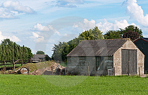 An Old Barn With Wooden Doors In A Dutch Landscape Stock Images - Image: 20079374