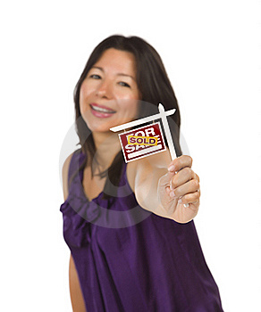 Multiethnic Woman Holding Sold Real Estate Sign Stock Photo - Image: 20084320