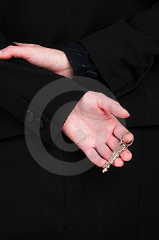 A Woman In A Black Suit Holding A Set Of Silver Keys Royalty Free Stock Photography - Image: 2011147